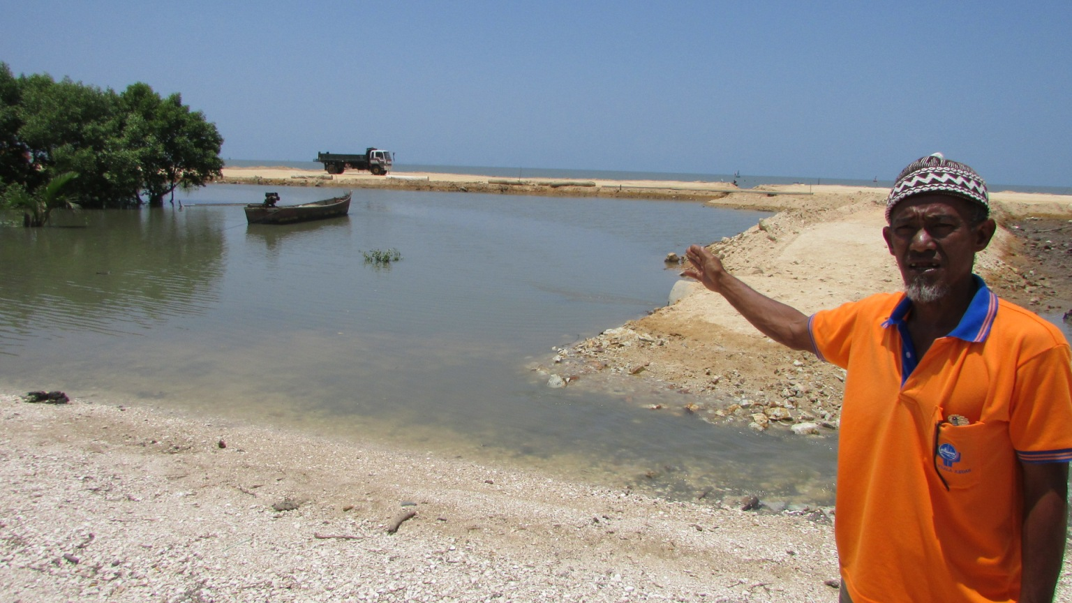 A fisherman shows the reclamation site | SAM
